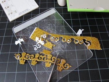cutting embellishments from gold foam
