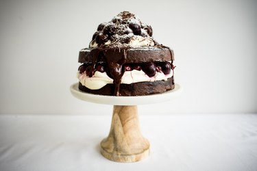 Black Forest cake on a cake stand.