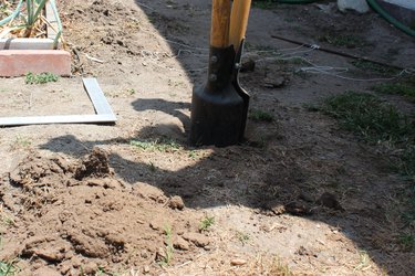 Using a post hole digger for posts.