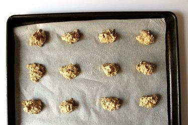Space teaspoon-sized cookie dough onto parchment paper
