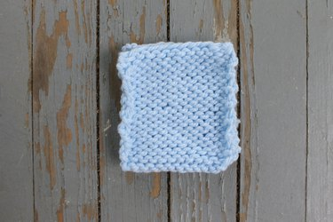 Two pieces of knitted fabric with the right sides together