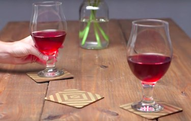 Gold stenciled coasters with wine glasses