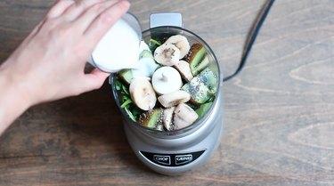 Pouring almond milk into food processor