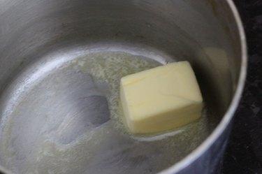 Melting butter in a medium sauce pan.