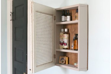 Open medicine cabinet with Burt's Bees products