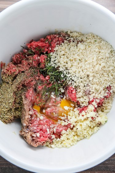 Combine the beef, garlic, egg, cheese, herbs, and bread crumbs.