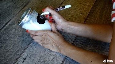 Dating mason jar full of milk for freezing.