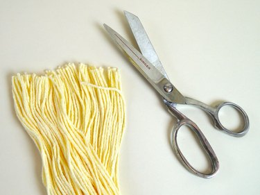 The trimmed ribbon and a pair of scissors.