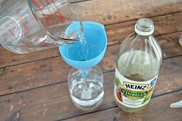 Add vinegar to the spray bottle.
