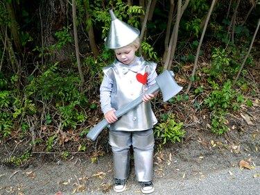 little boy dressed in tin man costume