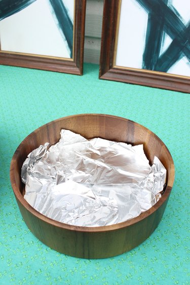 Cover the bottom of the bowl in aluminum foil.