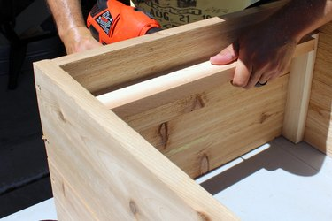 """drill pilot hole and deck screws to attach 16 1/4"""" wood slat 