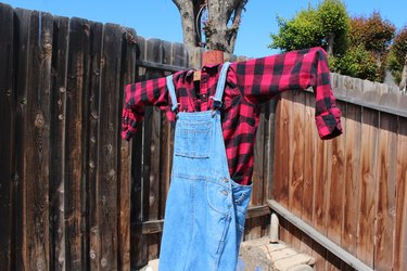 Dressing up the post with overalls.