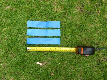 Three strips of tape and a ruler marking 7 inches.