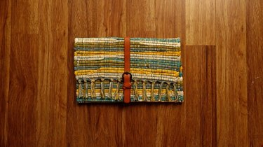 Upcycled no-sew clutch from a fabric placemat and faux leather belt