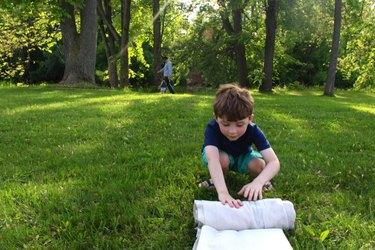 boy rolling portable hopscotch board