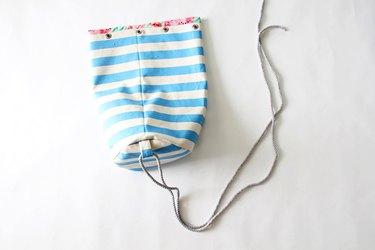 Slip rope through bottom strap