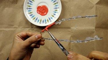 Painting DIY faux coral sculpture.
