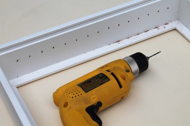 Drill a starter hole for the hooks.