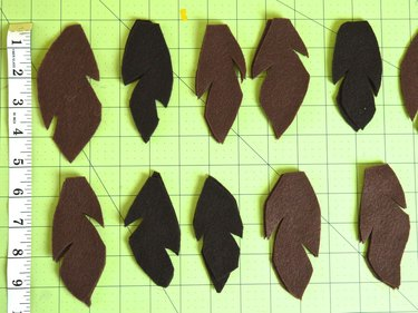 Two rows of brown feathers cut 5-inches long and 3-inches wide.