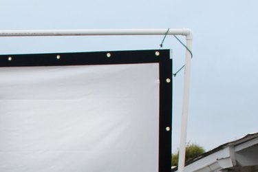 Hanging the screen material.