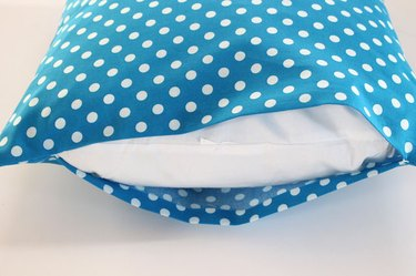 slide the pillow into the pillow case