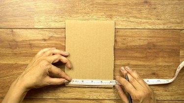 Measuring cardboard for cardboard weaving loom.