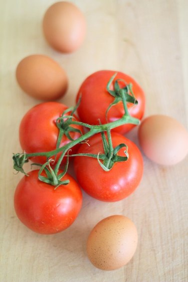 Fresh tomatoes and whole eggs.