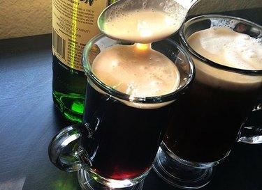Glasses of Irish coffee with freshly whipped cream.