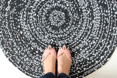 finished rope rug with pink shoes