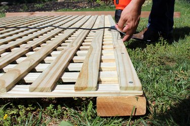 "drill 2"" deck screws into lattice and cedar board, top and bottom"