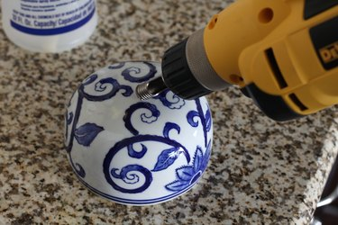 Drilling through the top of the lid at an angle