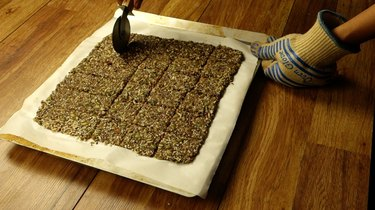 Scoring healthy seed and nut crispbread crackers.
