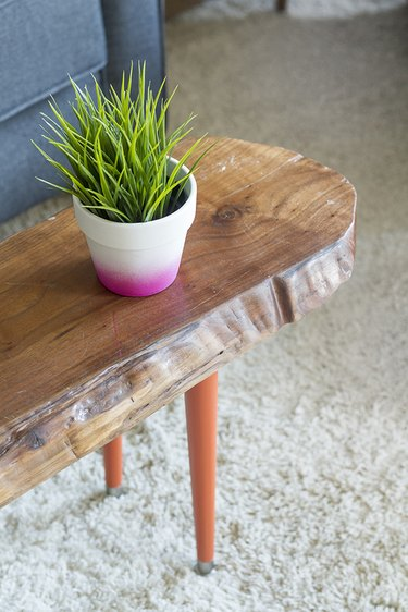 orange tapered wooden table legs