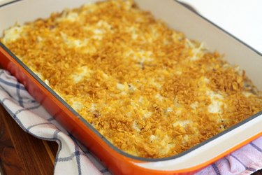 Hot cheesy potato casserole ready to serve.