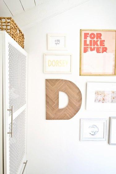 Herringbone letter hanging in gallery wall