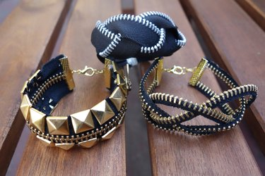 Three styles of bracelets made from zippers.