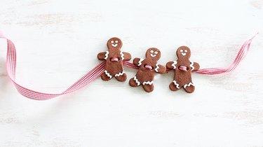 Threading ribbon through gingerbread men
