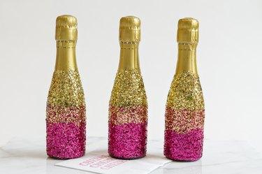 Glitter mini-champagne bottles.