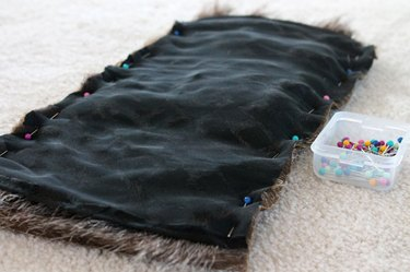 Pin the long edges of the lining and faux fur with right sides together.