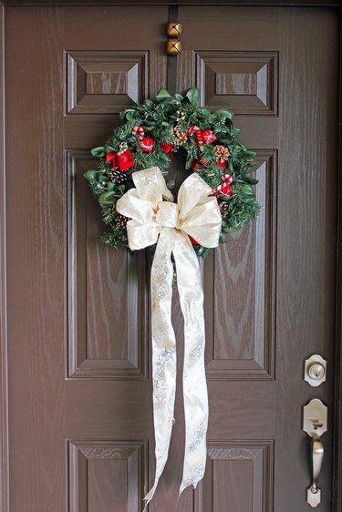 Create a Christmas bow with mesh ribbon and wreath wire and attach it to a wreath, mantle or front door.