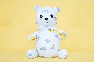 teddy bear made out of baby clothes
