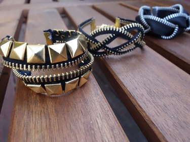 Three styles of DIY bracelets made out of zippers.