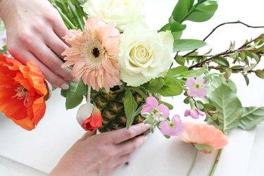 Arrange flowers into your pineapple vase