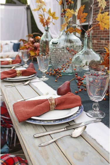 Fall tablescape with gold wire napkin rings.