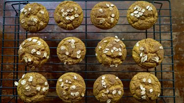 Fresh-baked pumpkin oat blender muffins topped with oats and cinnamon