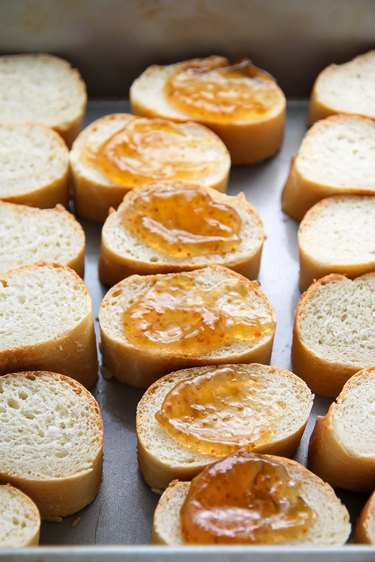 Top baguette with fig preserves.
