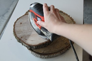 Using a palm sander to make the surface smooth