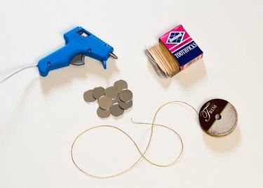 Supplies needed for DIY miniature sunburst mirror ornaments.