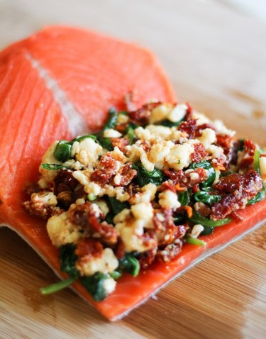 Salmon filet stuffed with ingredients.